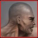 Zaheer's appearance - a severe bald human man.